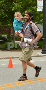 Photo by Albert J. Marro   The 41st Annual Crowley Brothers Memorial 10k Road Race was held Sunday morning with a run from Proctor to downtown Rutland. The day kicked off with a one mile children's race which drew dozens of future long distance runners. That race started and ended on Merchants Row but some youths needed a little help to make the finish.