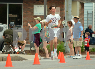 Photo by Albert J. Marro   The 41st Annual Crowley Brothers Memorial 10k Road Race was held Sunday morning with a run from Proctor to downtown Rutland. Nick Ojala of proctor won the 5k portion of the event by a mere 8 seconds..