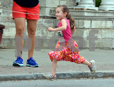 Photo by Albert J. Marro   The 41st Annual Crowley Brothers Memorial 10k Road Race was held Sunday morning with a run from Proctor to downtown Rutland. A young race in the 1 mile youth event wore her Sunday best for the race.