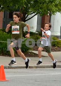 Photo by Albert J. Marro   The 41st Annual Crowley Brothers Memorial 10k Road Race was held Sunday morning with a run from Proctor to downtown Rutland. The day kicked off with a one mile children's race which drew dozens of future long distance runners. That race started and ended on Merchants Row. Some some it was sibling rivalry and a sprint to the finish.