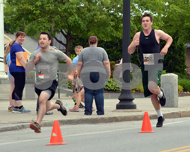 Photo by Albert J. Marro   The 41st Annual Crowley Brothers Memorial 10k Road Race was held Sunday morning with a run from Proctor to downtown Rutland. Brian Quirback, left, of Lowell, Ma., and Ryan Kelley of Brandon sprint to the finish. They ended in a dead heat.