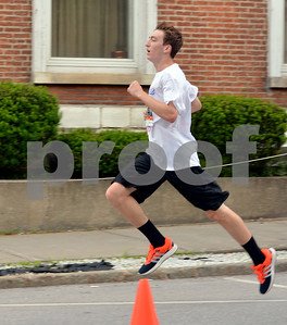 Photo by Albert J. Marro   The 41st Annual Crowley Brothers Memorial 10k Road Race was held Sunday morning with a run from Proctor to downtown Rutland. Proctor native Gannon McKearin spints to the finsih line in winning the men's 10k event.