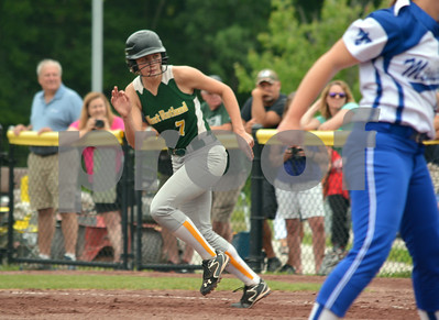 Photo by Albert J. Marro  West Rutland's Brooke Raiche is off withnthe crack of the batt during Saturday's washed-out twin bill of the North - South Softball Classic held at Castleton University. The annual all star games are hosted by the Vermont Softball Coaches Association. This year the weather won since the games were called in the bottom of the second inning as the South was coming to bat.