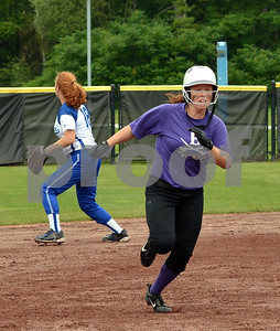 Photo by Albert J. Marro  Brattleboro's Devin Millerick heads to thridbase during Saturday's washed-out twin bill of the North - South Softball Classic held at Castleton University. The annual all star games are hosted by the Vermont Softball Coaches Association. This year the weather won since the games were called in the bottom of the second inning as the South was coming to bat.