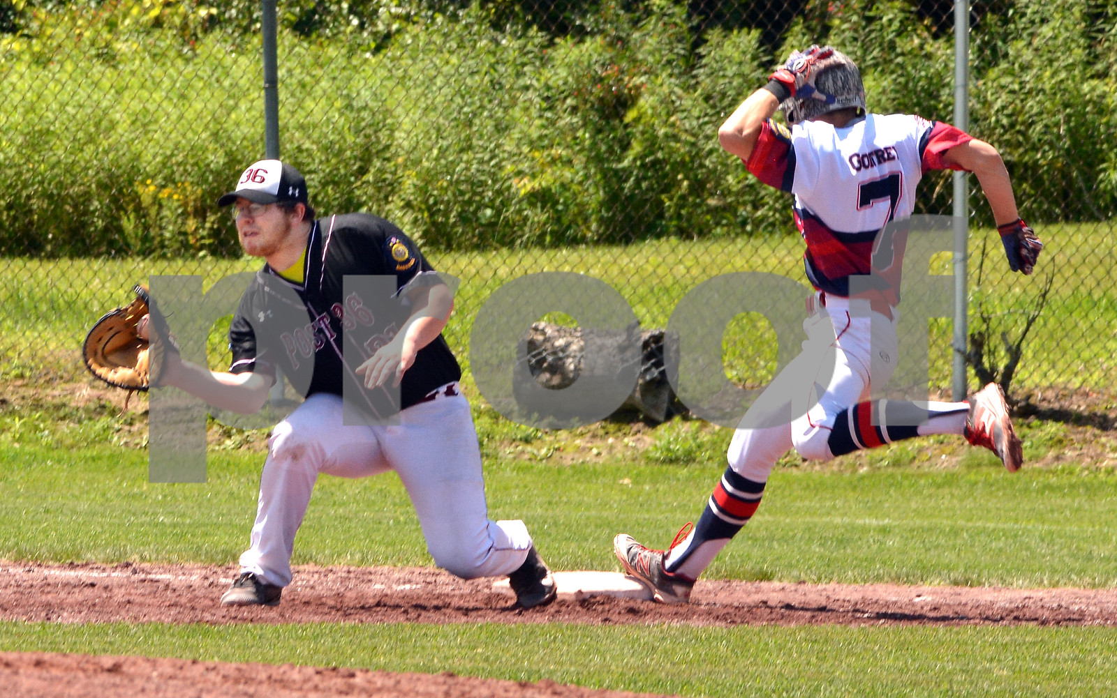Photo by Albert J. Marro   Post 31's Jacob Godfrey (7) was ruled safe at first during the opening game of Saturday's twinbill  against Ludlow Post 36  at St. Peter's Field in Rutland. Post 36 first baseman is John Letourneau.  Post 31 won  17-0.