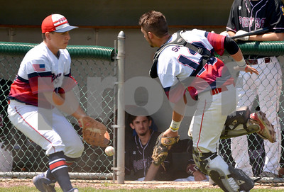 Photo by Albert J. Marro   Neither Post 31 pitcher Zach Bates , left, nor catcher Jaxon Smith could reach a foul pop during the first of two games against Ludlow Post 36 Saturday at St. Peter's Field in Rutland. Post 31 won  17-0.