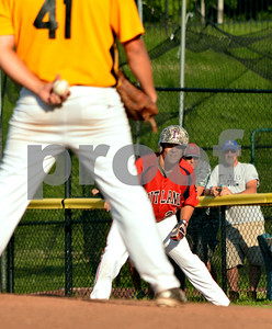 Photo by Albert J. Marro   Rutland Post 31's Josh Beayon studies Lakes Region pitcher Sam Eaton during Tuesday's conference game at Spartan Stadium in Castleton.