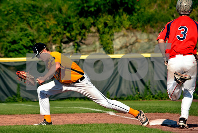 Photo by Albert J. Marro   Lakes Region first baseman Mitchell Brayman is near full extension as he stretches  to nip Post 31's Payson Williams (3)) at first during Tuesday's conference game at Spartan Stadium in Castleton.