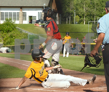 Photo by Albert J. Marro   Lakes Region Parker Morse slides safely into home during Tuesday's conference game against Rutland Post 31 at Spartan Stadium in Castleton.