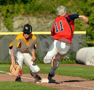Photo by Albert J. Marro   Lakes Region first baseman Mitchell Brayman scoops up a low throw to nip Post 31's  Reilly Shannon (11) at first during Tuesday's conference game at Spartan Stadium in Castleton.