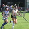 Robert Layman / Staff Photo Otter Valley's Isabella Falco, left, and Rutland's Stephanie Allen race for the ball during the varsity girl's field hockey game at Alumni Field Friday night. Raiders took an unanswered victory, 3-0.