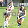 Robert Layman / Staff Photo Rutland's Lilly Krupp, left, tries to keep an agressive Isabella Falco away from the ball during the varsity girl's field hockey game at Alumni Field Friday night. Raiders took an unanswered victory, 3-0.