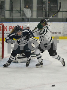 Photo by Albert J. Marro   Castleton 's Chanel Tvergyak (17) and Southern Maine's  Jensen Hamblett (21) chase after a loose puck in the Castleton zone during Saturday's matinee game at Spartan Arena in Rutland Town. CU won 4-1