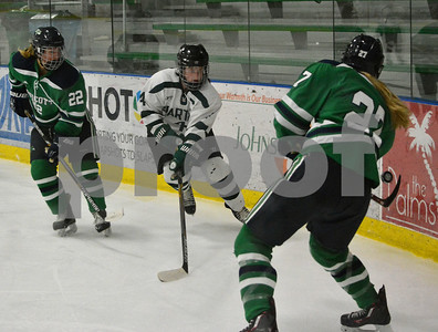 Photo by Albert J. Marro   Endicott's Nicole Demers (27) passes the puck up ice to teamate Courtney Walpole (22) during Saturday's opening round of the Rutland Herald Invatational at Spartan Arena in Rutland Town. Castleton's Hannah Wright n(4) applies pressure. The Gulls won 7-3.