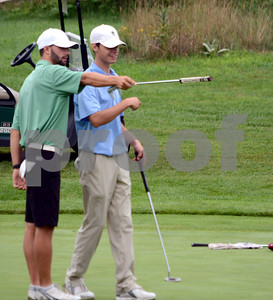 Photo by Albert J. Marro  Justin DelBianco, left, and Nick Ojala looks over a putt  during second round of the 2018 L.D. Pierce Invittational Golf Tournament being played at Rutland Country Club.