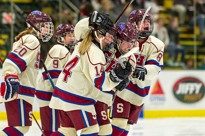 Spaulding celebrates Bria Dill's second period score during their 4-0 DII championship victory over CVU on Monday at the Gutterson Fieldhouse in Burlington.