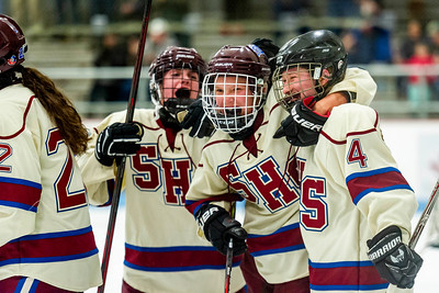 Spaulding players celebrate Camryn Bell's score, which put the Crimson Tide ahead 4-2 in their eventual 5-2 win over Rice on Wednesday in Barre.