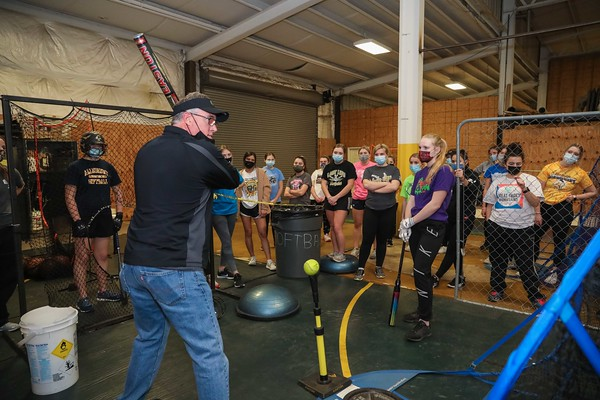 John Christner, assistant coach for the Belle Vernon softball team, instructs the team on batting techniques at an indoor practice on March 19, 2021.