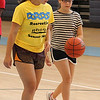 Peabody, Ma. 8-7-17. Instructor Jordan Muse works with Olivia Monsini on shooting drills during girl's basketball camp at the Higgins Middle School.