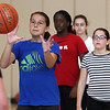 Peabody, Ma. 8-7-17. Victoria McCoy, Ketsia Kabeya, Olivia Monsini and Ashley Milne pratice shooting at girl's basketball camp held at the Higgins Middle School.