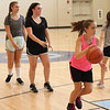 Peabody, Ma. 8-7-17. Emily DiCologero, Emma Ruggera and Katie Amico practice shooting drills at girl's basketball camp at the Higgins Middle School.