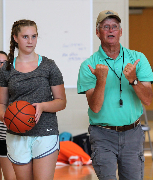 Peabody, Ma. 8-7-17. Emily DiCologero listens to Coach Bill Linehan during the girl's basketball camp held at the Higgins Middle School.
