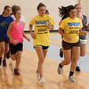 Peabody, Ma. 8-7-17. Victoria Milne, Katie Amico, Carla Patania, Jordan Muse, Emily DiCologero and others warm up before starting basketball drills at the girl's basketball camp at the Higgins Middle School.