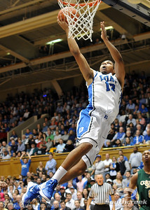 Duke's Michael Gbinije goes to the basket during the basketball game between the Colorado State Rams and the Duke Blue Devils at Cameron Indoor Stadium, Durham, North Carolina.  The Blue Devils defeated the Rams 87-64.