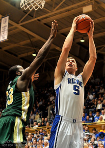 Duke Forward Mason Plumlee goes to the basket during the basketball game between the Colorado State Rams and the Duke Blue Devils at Cameron Indoor Stadium, Durham, North Carolina.