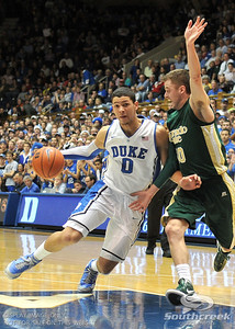 Duke Guard Austin Rivers drives to the basket during the basketball game between the Colorado State Rams and the Duke Blue Devils at Cameron Indoor Stadium, Durham, North Carolina.