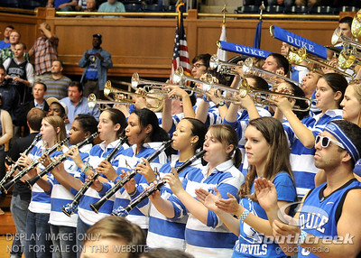 The pep band revs up the crowd during the basketball game between the Colorado State Rams and the Duke Blue Devils at Cameron Indoor Stadium, Durham, North Carolina.