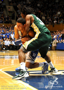 Opposing players tie up the ball during the basketball game between the Colorado State Rams and the Duke Blue Devils at Cameron Indoor Stadium, Durham, North Carolina.