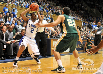 Duke Blue Devils Quinn Cook looks to pass the ball during the basketball game between the Colorado State Rams and the Duke Blue Devils at Cameron Indoor Stadium, Durham, North Carolina.