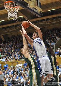 Duke's Mason Plumlee goes for a layup during the basketball game between the Colorado State Rams and the Duke Blue Devils at Cameron Indoor Stadium, Durham, North Carolina.  The Blue Devils defeated the Rams 87-64.