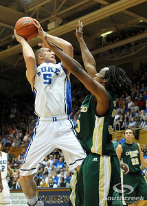 Duke's Mason Plumlee shoots the ball during the basketball game between the Colorado State Rams and the Duke Blue Devils at Cameron Indoor Stadium, Durham, North Carolina.  The Blue Devils defeated the Rams 87-64.