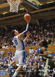 Duke's Austin Rivers goes for a reverse during the basketball game between the Colorado State Rams and the Duke Blue Devils at Cameron Indoor Stadium, Durham, North Carolina.  The Blue Devils defeated the Rams 87-64.
