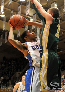 Duke Blue Devils Quinn Cook goes to the basket during the basketball game between the Colorado State Rams and the Duke Blue Devils at Cameron Indoor Stadium, Durham, North Carolina.