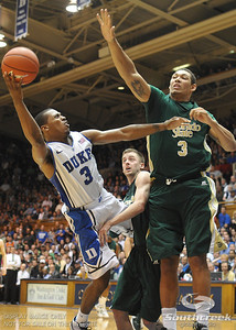 Duke's Tyler Thornton tries to shoot the ball during the basketball game between the Colorado State Rams and the Duke Blue Devils at Cameron Indoor Stadium, Durham, North Carolina.  The Blue Devils defeated the Rams 87-64.
