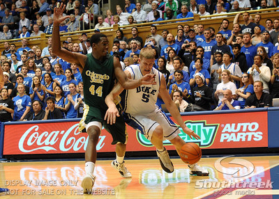 Duke's Mason Plumlee dribbles along the baseline during the basketball game between the Colorado State Rams and the Duke Blue Devils at Cameron Indoor Stadium, Durham, North Carolina.