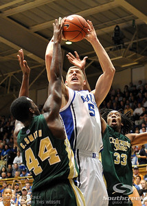 Duke's Mason Plumlee goes to the basket during the basketball game between the Colorado State Rams and the Duke Blue Devils at Cameron Indoor Stadium, Durham, North Carolina.