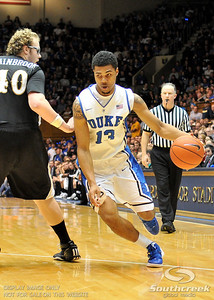 Blue Devil's Forward Michael Gbinije (F) drives to the basket during the basketball game between the Western Michigan Broncos and the Duke Blue Devils at Cameron Indoor Stadium, Durham, North Carolina.  The Blue Devils defeated the Broncos 110-70.