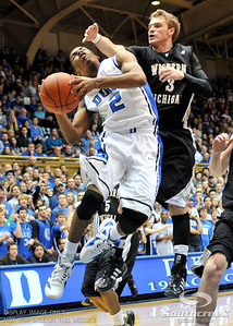 Blue Devil's Guard Quinn Cook (F) is defended by Bronco's Guard Hayden Hoerdemann during the basketball game between the Western Michigan Broncos and the Duke Blue Devils at Cameron Indoor Stadium, Durham, North Carolina.  The Blue Devils defeated the Broncos 110-70.