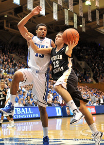 Broncos Guard Austin Richie drives to the basket against Blue Devil's Forward Michael Gbinije (F) during the basketball game between the Western Michigan Broncos and the Duke Blue Devils at Cameron Indoor Stadium, Durham, North Carolina.  The Blue Devils defeated the Broncos 110-70.