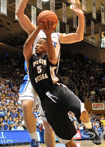 Bronco's Guard Mike Douglas drives to the hoop during the basketball game between the Western Michigan Broncos and the Duke Blue Devils at Cameron Indoor Stadium, Durham, North Carolina.  The Blue Devils defeated the Broncos 110-70.