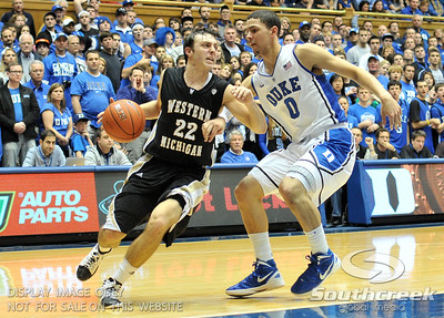 Bronco's Guard Austin Richie is guarded by Blue Devil's Guard Austin Rivers (F)during the basketball game between the Western Michigan Broncos and the Duke Blue Devils at Cameron Indoor Stadium, Durham, North Carolina.  The Blue Devils defeated the Broncos 110-70.