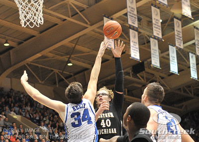 Bronco's Forward Matt Stainbrook shoots over Blue Devil's Forward Ryan Kelly (J) during the basketball game between the Western Michigan Broncos and the Duke Blue Devils at Cameron Indoor Stadium, Durham, North Carolina.  The Blue Devils defeated the Broncos 110-70.