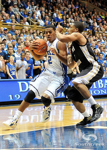 Blue Devil's Guard Quinn Cook (F) drives to the basket during the basketball game between the Western Michigan Broncos and the Duke Blue Devils at Cameron Indoor Stadium, Durham, North Carolina.  The Blue Devils defeated the Broncos 110-70.