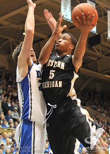 Bronco's Guard Mike Douglas drives to the goal against Blue Devil's Forward Ryan Kelly (J) during the basketball game between the Western Michigan Broncos and the Duke Blue Devils at Cameron Indoor Stadium, Durham, North Carolina.  The Blue Devils defeated the Broncos 110-70.