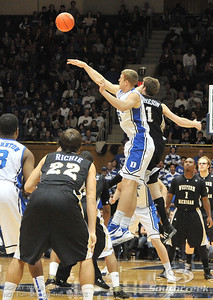 Blue Devil's Forward Mason Plumlee (J) wins the tip-off during the basketball game between the Western Michigan Broncos and the Duke Blue Devils at Cameron Indoor Stadium, Durham, North Carolina.  The Blue Devils defeated the Broncos 110-70.