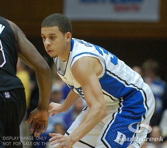 Duke Blue Devils Guard Seth Curry (J) plays some intense defense during the basketball game between the Duke Blue Devils and the NC State Wolfpack at Cameron Indoor Stadium, Durham NC.  Duke came from 20 points behind with 11 minutes remaining to win the game, 78-73.